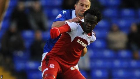 Middlesbrough's Kei Kamara (front) and Birmingham City's Dariusz Dudka (back) battle for the ball