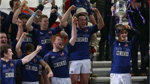Queen's captain Stuart McIlwaine lifts the Senior Cup