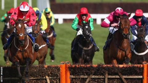 Sam Twiston-Davies riding The New One clears the last fence on his way to victory in the Novices' Hurdle Race during Ladies Day at Cheltenham Racecourse on March 13, 2013.