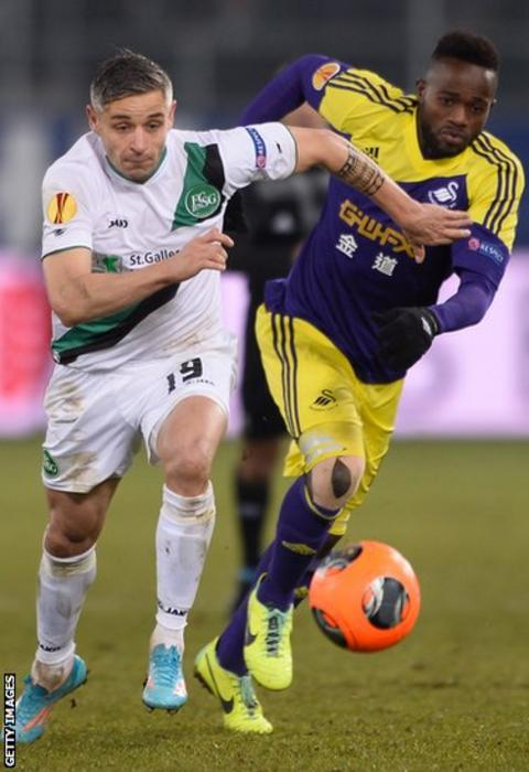 St Gallen midfielder Mario Mutsch battles for the ball with Swansea City's Roland Lamah during the Europa League game at the AFG Arena.