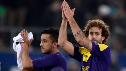 Neil Taylor and Jose Canas applaud the travelling Swansea fans following their 1-0 defeat to St Gallen, although the Swans advanced to the knock-out stages of the Europa League.