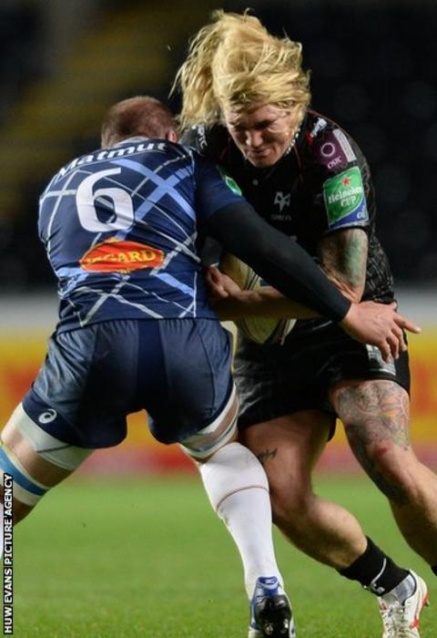 Wales hooker Richard Hibbard takes on Jannie Bornman during Ospreys' Heineken Cup clash against Castres at the Libert Stadium.