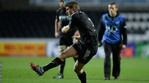 Ospreys fly-half Dan Biggar kicks at goal during his side's home Heineken Cup match against Castres.