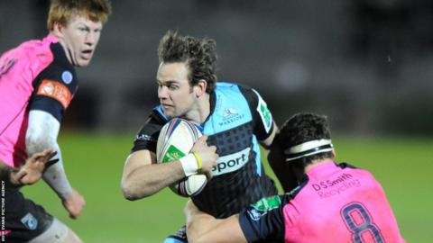 Cardiff Blues' Robin Copeland tackles Glasgow fly-half Ruaridh Jackson as Rhys Patchell looks on