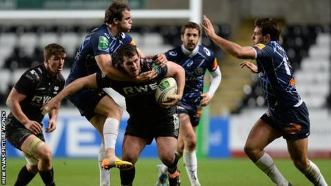Ospreys' Ryan Bevington is tackled by Remi Lamerat