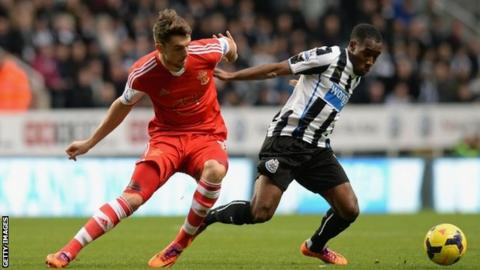 Vurnon Anita of Newcastle United tackles Jay Rodriguez of Southampton