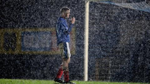 It was a wet and windy Windsor Park for Aaron Burns and the rest of the Linfield and Ballinamallard players
