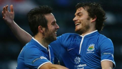 Andrew Waterworth is congratulated by Linfield team-mate Philip Lowry after scoring against Ballinamallard United