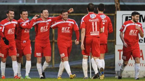 Gary Twigg celebrates with his team-mates after scoring the second goal in Portadown's 2-0 win over Coleraine