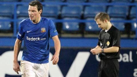 Glenavon defender Kyle Neill leaves the field after being sent-off by referee Tim Marshall in the Mourneview Park game against Ballymena United
