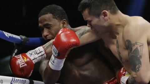 Adrien Broner (left) is caught with a punch from Marcos Maidana