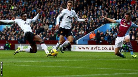Manchester United striker Danny Welbeck (left) scores his side's second against Aston Villa