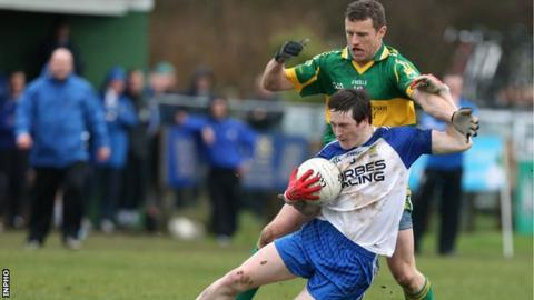 Ballinderry's Gareth McKinless is challenged by Kevin Waldron of Kingdom Kerry Gaels