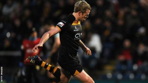 Joe Carlisle of London Wasps kicks a penalty during the Amlin Challenge Cup match between London Wasps and Grenoble