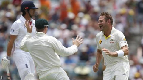 Ryan Harris (right) celebrates after bowling Alastair Cook (left)