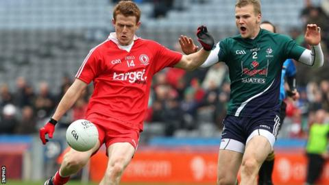 Peter Hughes is challenged by Kildare's Peter Kelly