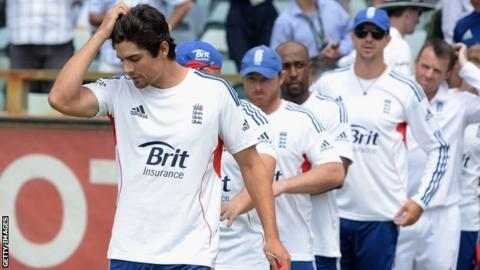 Alastair Cook leads the England players after their defeat in Perth