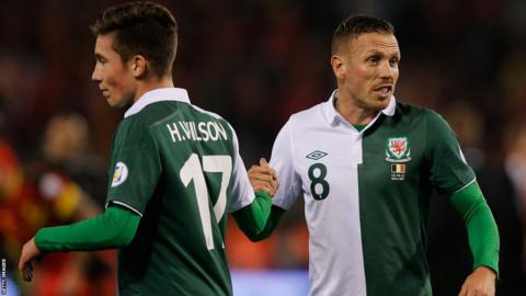 Out with the old, in with the new: Liverpool's Harry Wilson at 16 became Wales' youngest ever player on the same evening Craig Bellamy made his final appearance for the national team in a 1-1 draw in Belgium.