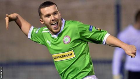 Martin Donnelly celebrates after putting Cliftonville ahead at Clandeboye Park
