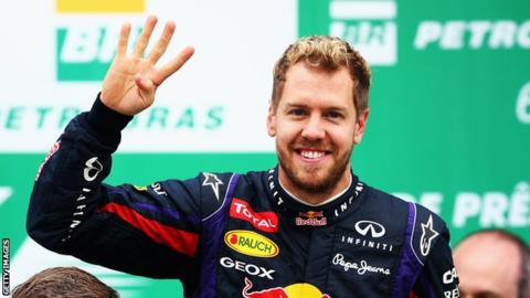 Sebastian Vettel celebrates his fourth World Championship after victory at the Brazilian Grand Prix.