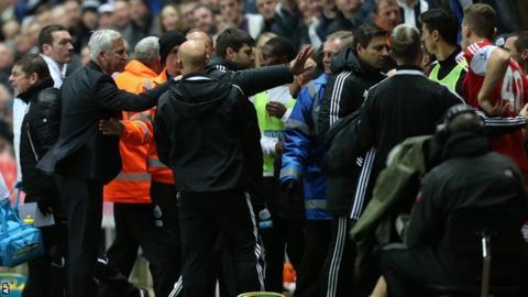 Newcastle and Southampton players and staff clashing