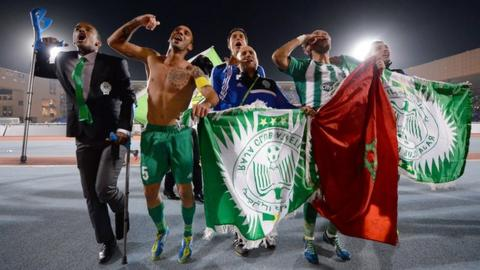 Raja Casablanca players celebrate victory over Atletico Mineiro