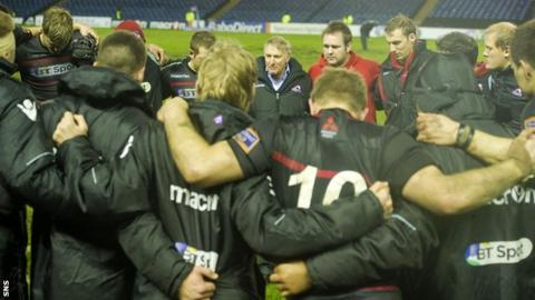 Head coach Alan Solomons addresses the Edinburgh players after an 11-6 win over Leinster