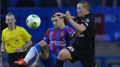 Glentoran's Stephen McAlorum battles with Scott Davidson of Ards