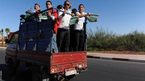 Raja Casablanca fans make their way to the stadium by pick up truck before the Fifa Club World Cup Final between Raja Casablanca and FC Bayern Munich at the Marrakech Stadium
