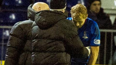 Inverness Caley Thistle forward Richie Foran receives treatment