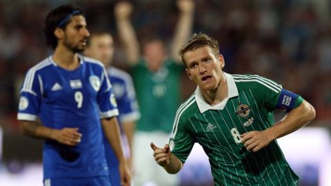 Northern Ireland skipper Steven Davis celebrates scoring in the 1-1 draw against Israel in October. It was the final game in a disappointing World Cup qualifying campaign, with Michael O'Neill's team finishing fifth in Group F