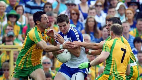 Donegal pair Rory Kavanagh and Paddy McGrath challenge Monaghan's Darren Hughes in the Ulster SFC final as the Farney men caused a huge upset by winning 0-13 to 0-7