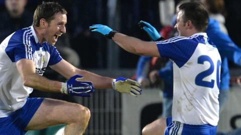 Ballinderry pair Enda Muldoon and Darren Conway celebrate after the Derry team defeated Glenswilly to clinch a third Ulster Club Football title