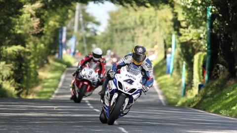 Guy Martin leads Michael Dunlop as the Englishman races to one of three victories at the Ulster Grand Prix in August