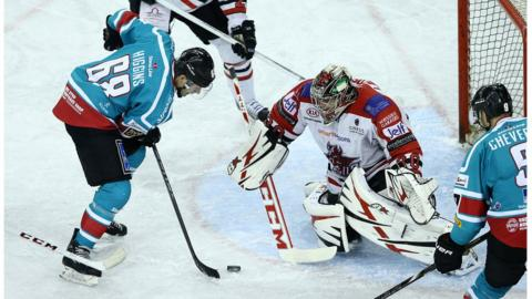 Belfast Giants player Chris Higgins takes a shot against Cardiff Devils. The Odyssey team are currently top of the Elite League under coach Paul Adey, who was appointed after Doug Christiansen joined the Sheffield Steelers