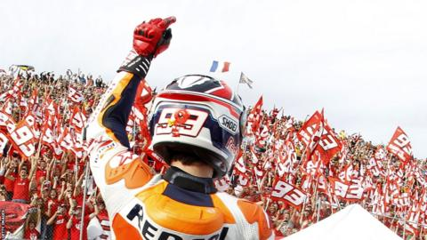 Spain's Marc Marquez celebrates becoming world champion in his debut season in MotoGP.