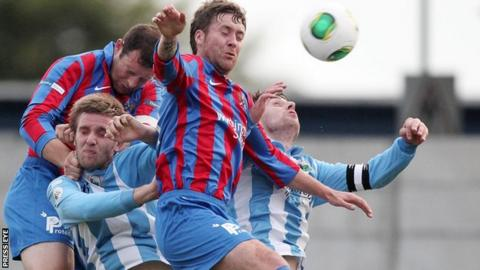 Ards in Irish Premiership action against Warrenpoint Town