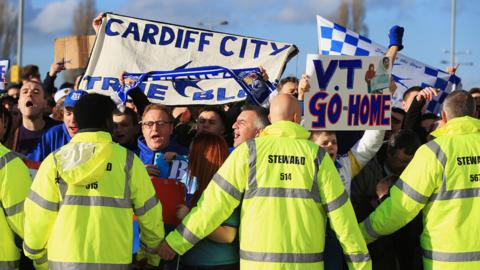 Cardiff City fans protest against owner Vincent Tan before the Boxing Day match with Southampton in Cardiff