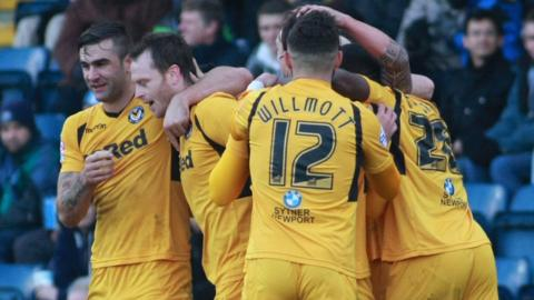 Newport County's players congratulate Michael Flynn after his goal put them ahead against Wycombe Wanderers. Newport won the game 1-0
