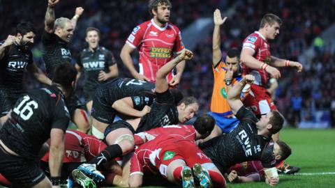 Ospreys celebrate as second row Ian Evans touches down for the only try of the match in their 10-6 victory over Scarlets on Boxing Day