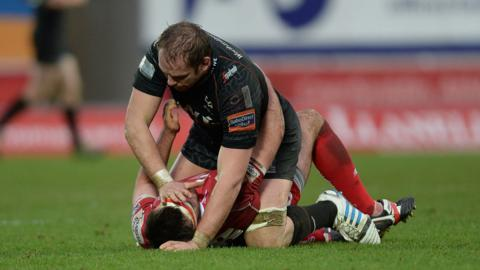 Ospreys captain Alun Wyn Jones and Scarlets' hooker Emyr Phillips appear to be a little short on Christmas cheer during the Boxing Day derby match at Parc Y Scarlets. Ospreys won 10-6