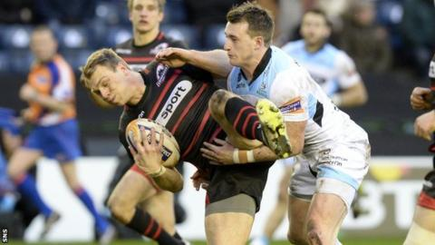 Edinburgh's Greig Tonks is tackled by Stuart Hogg