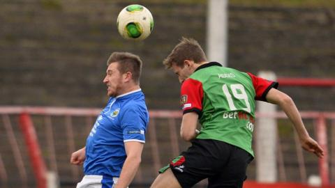 Mark McAllister and Johnny Addis in aerial action during Linfield's 2-1 win over Belfast rivals Glentoran at the Oval
