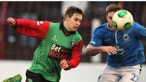 Glentoran's Jordan Stewart and Jamie Mulgrew of Linfield battle for possession during the Premiership game on Boxing Day