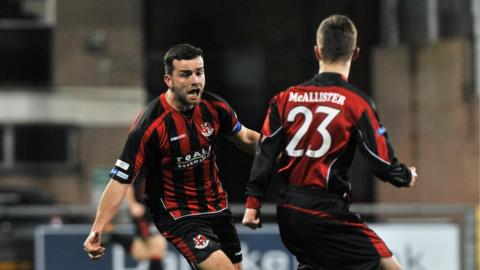 Colin Coates celebrates after scoring Crusaders's late equaliser against Cliftonville at Seaview