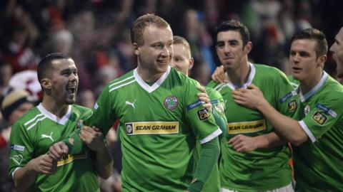 Liam Boyce celebrates after putting Cliftonville in front from the penalty spot against north Belfast derby rivals Crusaders