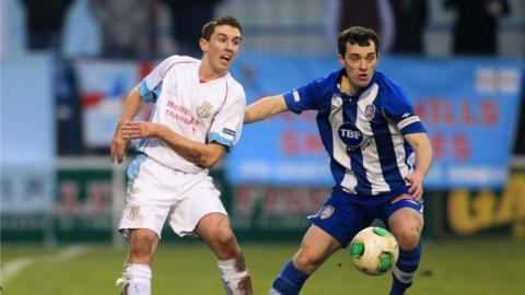 Gary Thompson and Michael Hegarty in action in the Boxing Day clash at Ballycastle Road