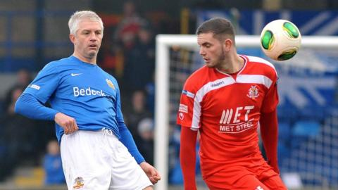 William Murphy keeps a close eye on Portadown striker Darren Murray in the Boxing Day game at Lurgan