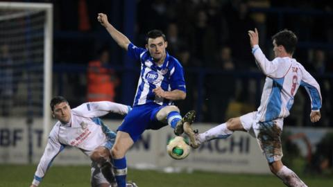 Davy Munster and Gavin Taggart challenge Coleraine's Michael Hegarty