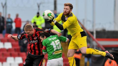Chris Morrow in action with Cliftonville's Eamonn Seydak and Conor Devlin at Seaview